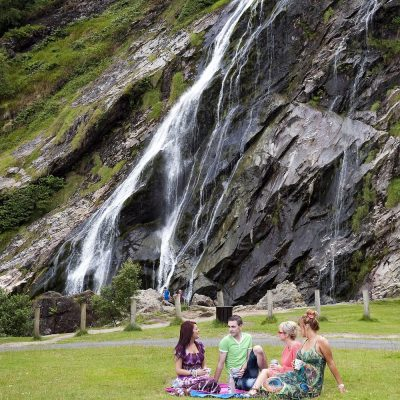 Group sitting at Glendalough waterfall, Wicklow, 2011, Portrait